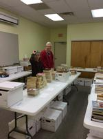 Patsy Krauskopf and Bob Morford prepare for the Ellis Memorial Library Annual Book Sale.